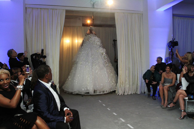 Preston Bailey enter under a bridal gown
