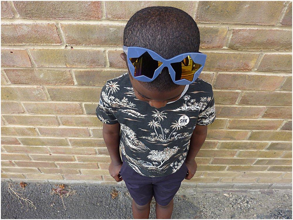 Little black boy in a black summer print t-shirt
