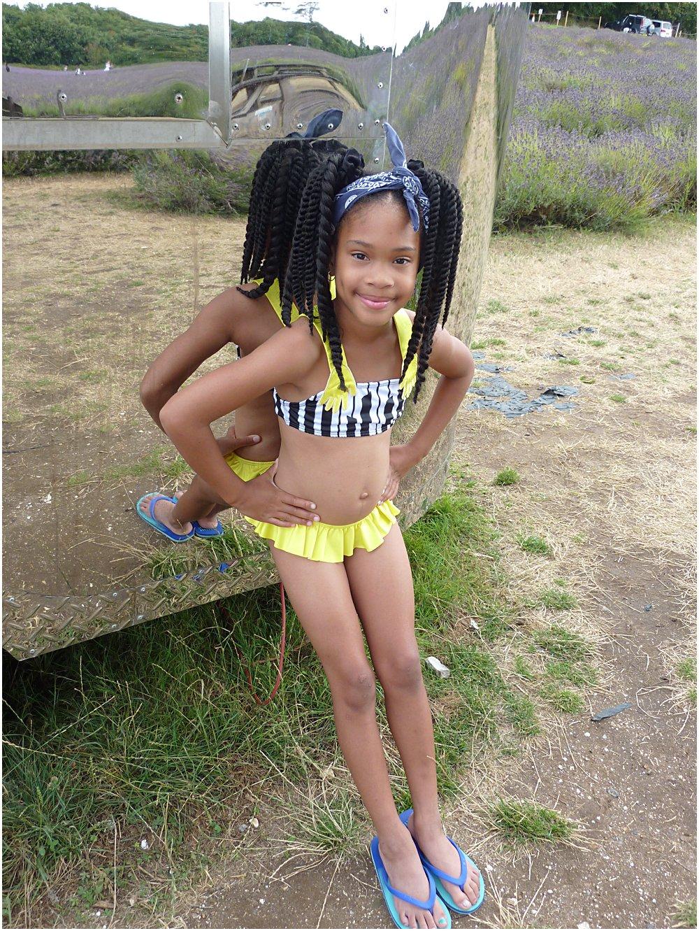 Little black girl wearing Raspberry Plum SS18 Piano inspired bikini