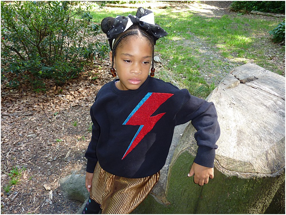 Little black girl wearing a statement jumper a trend for AW18