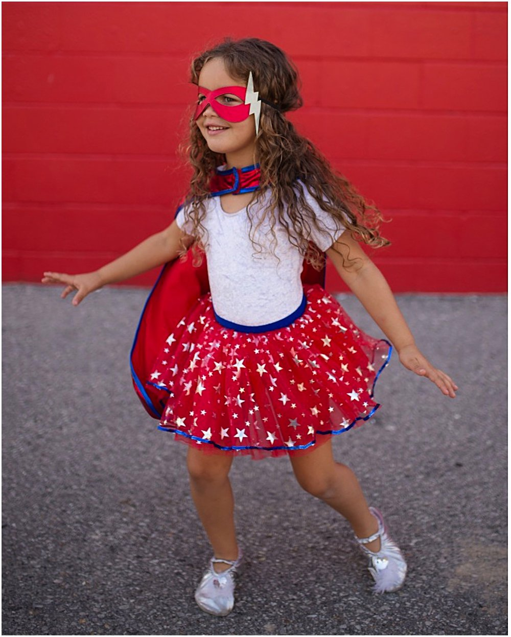 LITTLE GIRL WEARING GREAT PRETENDERS SUPERHERO COSTUME