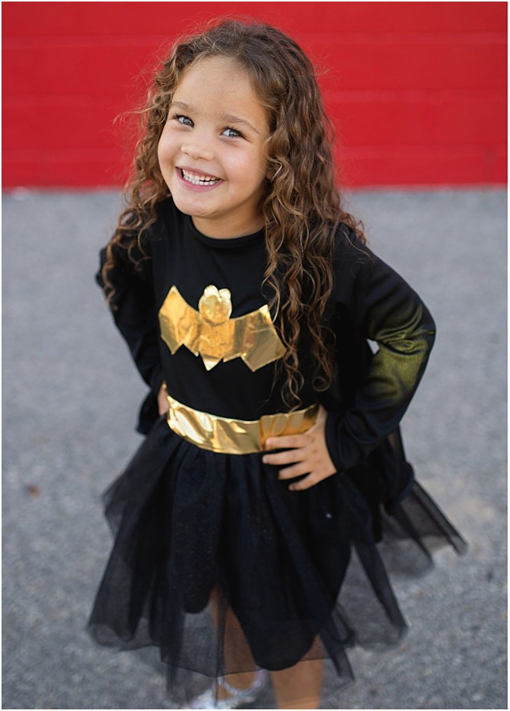 LITTLE GIRL WEARING GREAT PRETENDERS BATGIRL COSTUME