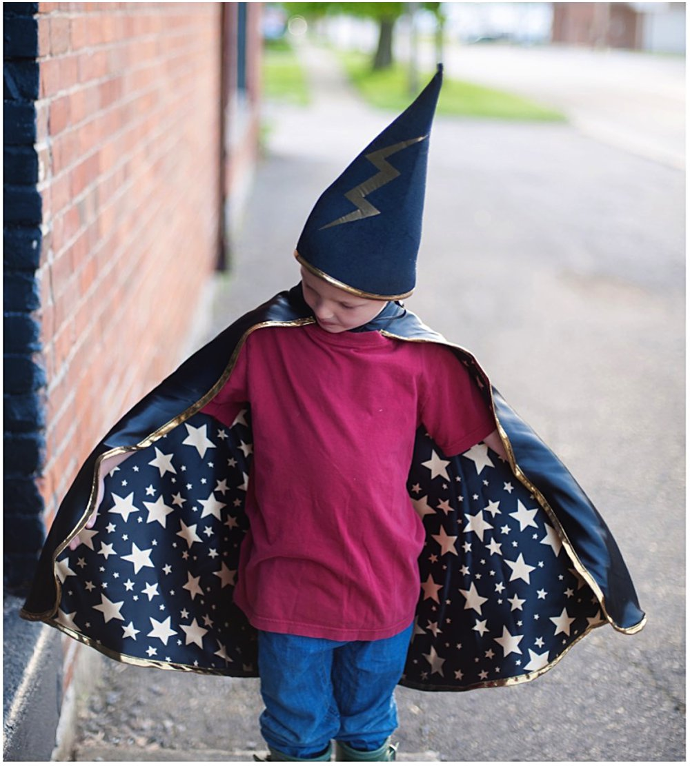 Little Boy wears Great Pretenders reversible wizard cape and hat